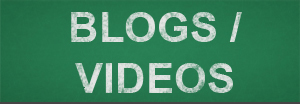 Green chalkboard with White text stating Blogs/Videos.