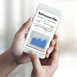 "Two Hands Holding Cell Phone with ""Retirement Plan"" and Graph on the Screen"