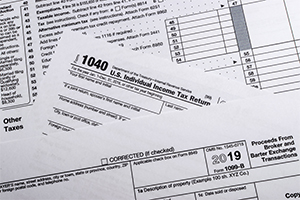 A 1040 Tax Form is displayed.